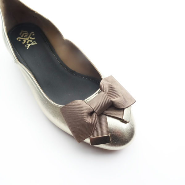 gold ballerinas with bows